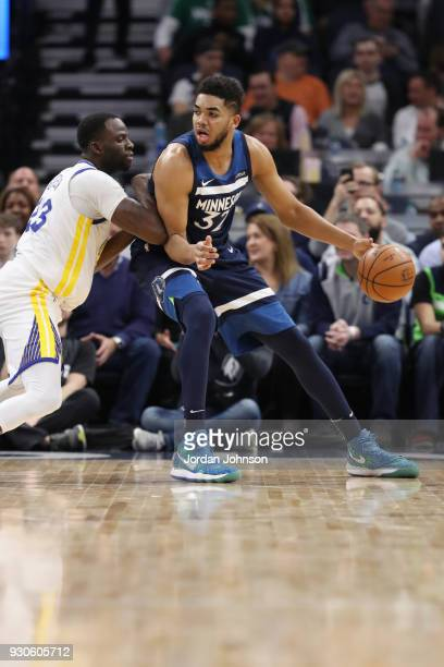 KarlAnthony Towns of the Minnesota Timberwolves handles the ball during the game against the Golden State Warriors on March 11 2018 at Target Center...