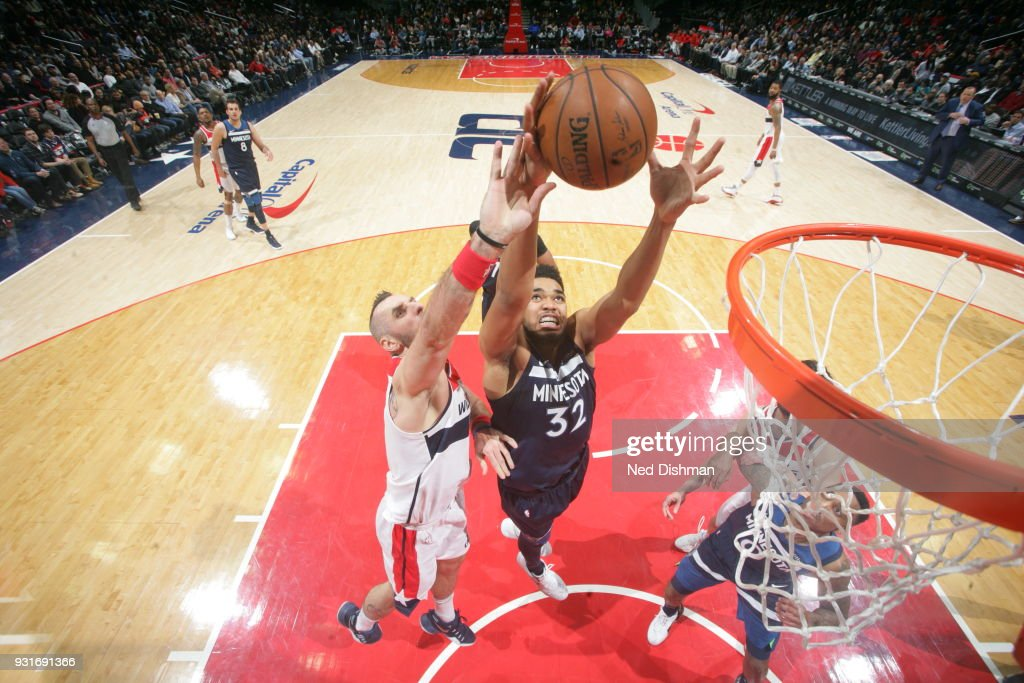 Karl-Anthony Towns #32 of the Minnesota Timberwolves handles the ball against the Washington Wizards on March 13, 2018 at Capital One Arena in Washington, DC.