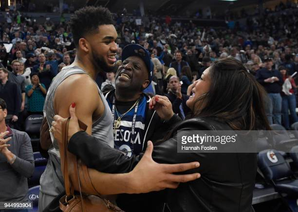 Karl-Anthony Towns of the Minnesota Timberwolves hugs his parents, Karl and Jackie Towns after winning the game against the Denver Nuggets on April...