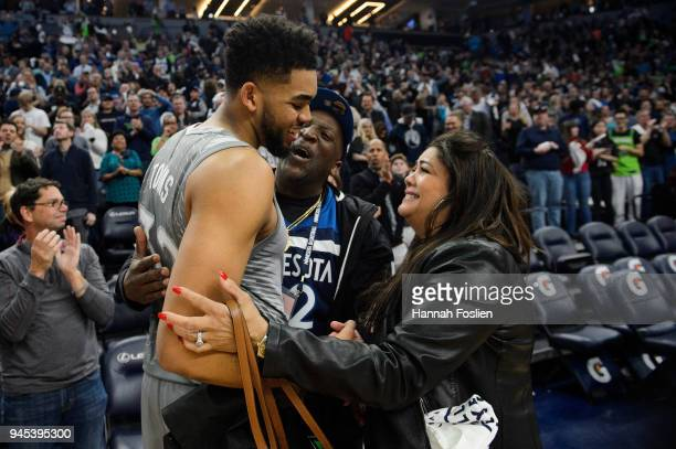 Karl-Anthony Towns of the Minnesota Timberwolves hugs his parents, Karl and Jackie Towns after winning the game against the Denver Nuggets of the...