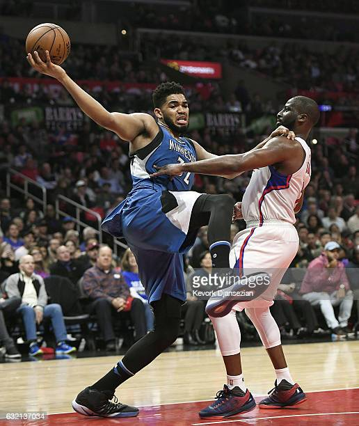 KarlAnthony Towns of the Minnesota Timberwolves is defended by Raymond Felton of the Los Angeles Clippers during the first half half of the...
