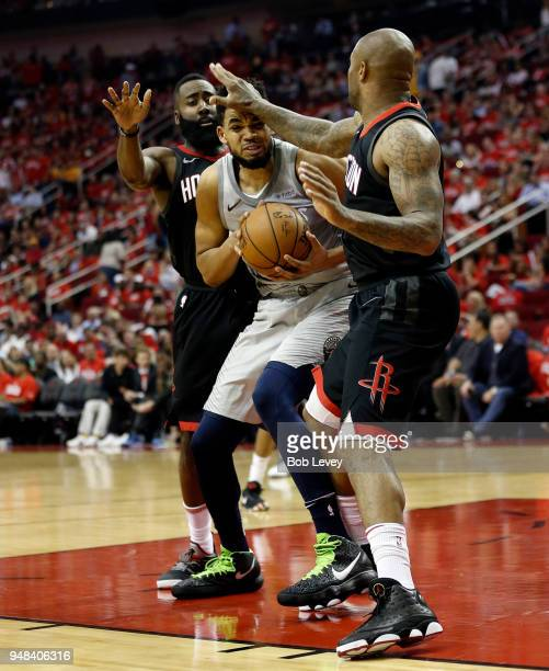 KarlAnthony Towns of the Minnesota Timberwolves is double teamed by James Harden of the Houston Rockets and PJ Tucker during Game Two of the first...