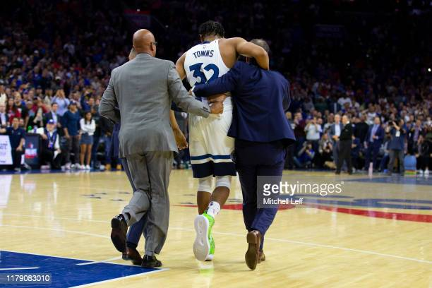 KarlAnthony Towns of the Minnesota Timberwolves is helped to his bench after getting into a fight with Joel Embiid of the Philadelphia 76ers in the...