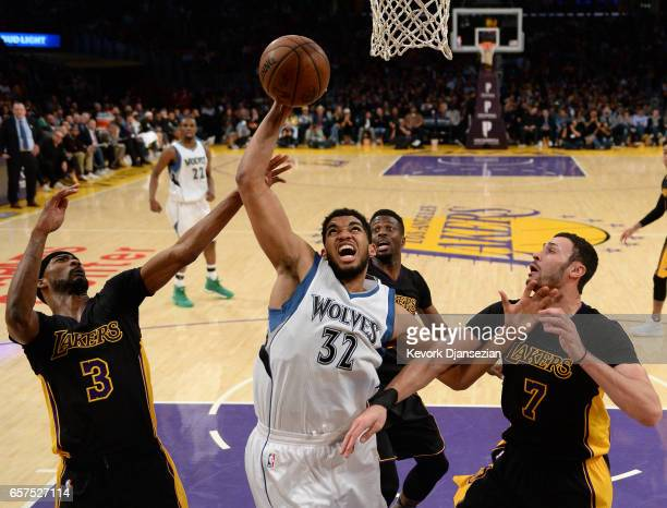 KarlAnthony Towns of the Minnesota Timberwolves is surrounded by Corey Brewer Larry Nance Jr #7 and David Nwaba of the Los Angeles Lakers as the...