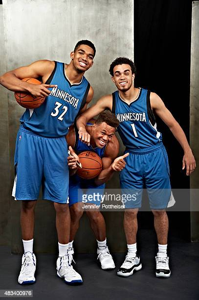 KarlAnthony Towns of the Minnesota Timberwolves Justin Anderson of the Dallas Mavericks and Tyus Jones and of the Minnesota Timberwolves poses for a...