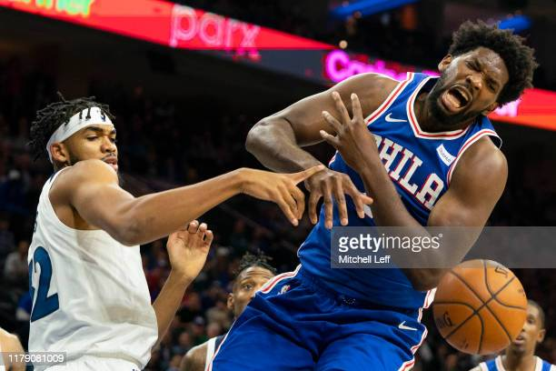 KarlAnthony Towns of the Minnesota Timberwolves knocks the ball out of the hands of Joel Embiid of the Philadelphia 76ers in the first quarter at the...