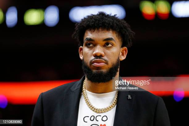 Karl-Anthony Towns of the Minnesota Timberwolves looks on against the Miami Heat during the second half at American Airlines Arena on February 26,...