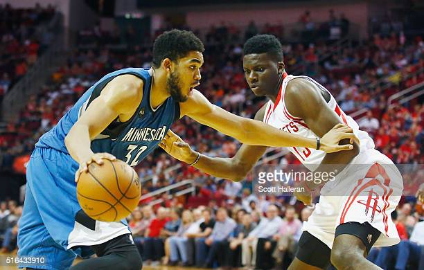 KarlAnthony Towns of the Minnesota Timberwolves looks to drive with the basketball in front of Clint Capela of the Houston Rockets during their game...