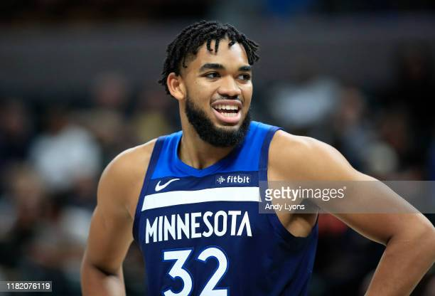 Karl-Anthony Towns of the Minnesota Timberwolves looks to rebound the ball against the Indiana Pacers at Bankers Life Fieldhouse on October 15, 2019...