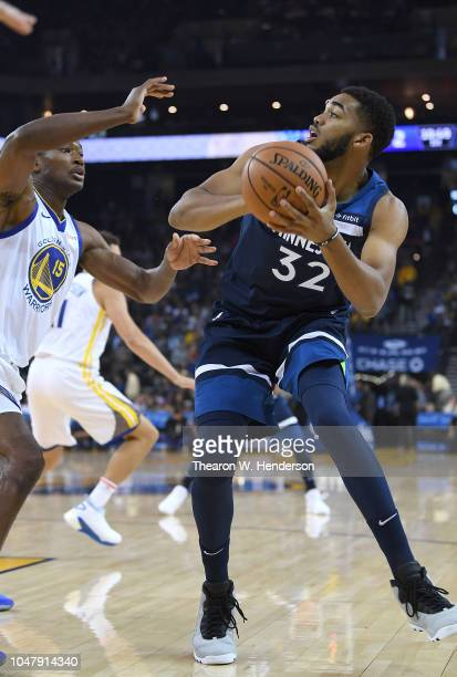 KarlAnthony Towns of the Minnesota Timberwolves looks to shoot over Damian Jones of the Golden State Warriors during an NBA basketball game at ORACLE...