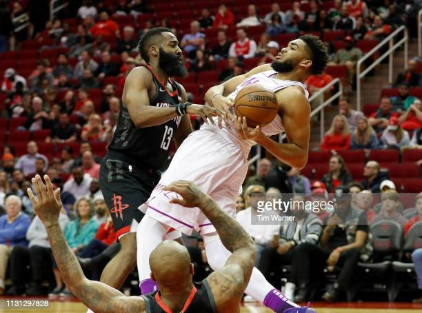 KarlAnthony Towns of the Minnesota Timberwolves looses control of the ball defended by James Harden of the Houston Rockets and PJ Tucker in the...
