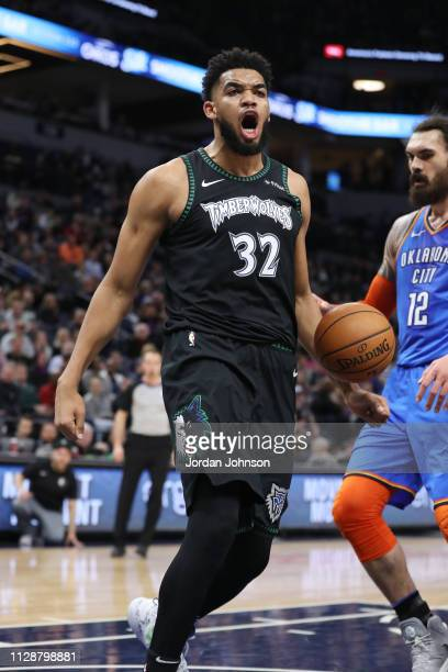 KarlAnthony Towns of the Minnesota Timberwolves reacts after dunking the ball against the Oklahoma City Thunder on March 15 2019 at Target Center in...
