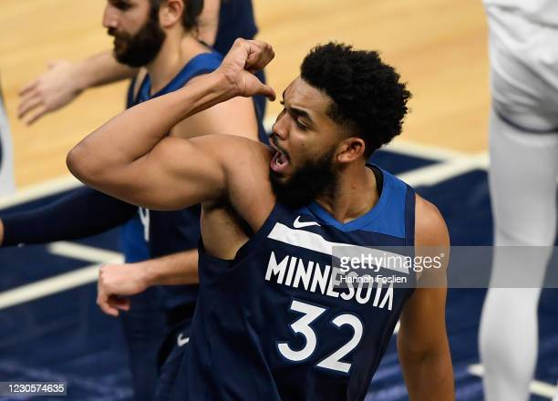 Karl-Anthony Towns of the Minnesota Timberwolves reacts during the fourth quarter of the game against the Minnesota Timberwolves at Target Center on...