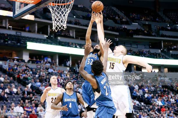 KarlAnthony Towns of the Minnesota Timberwolves rebounds ball over Nikola Jokic of the Denver Nuggets on February 15 2017 at the Pepsi Center in...
