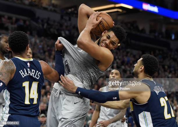 KarlAnthony Towns of the Minnesota Timberwolves rebounds the ball against Gary Harris and Jamal Murray of the Denver Nuggets during the fourth...