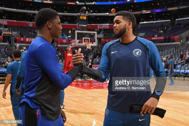 KarlAnthony Towns of the Minnesota Timberwolves shakes hands with Angel Delgado of the LA Clippers before the game during a preseason game on October...