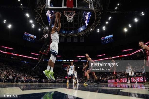 KarlAnthony Towns of the Minnesota Timberwolves shoots the ball against Kendrick Nunn of the Miami Heat on October 27 2019 at Target Center in...