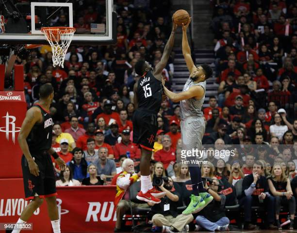 KarlAnthony Towns of the Minnesota Timberwolves shoots the ball against Clint Capela of the Houston Rockets in the first half during Game One of the...