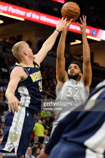 KarlAnthony Towns of the Minnesota Timberwolves shoots the ball against Mason Plumlee of the Denver Nuggets during the game on April 11 2018 at the...