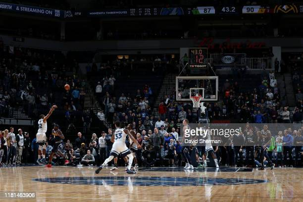 KarlAnthony Towns of the Minnesota Timberwolves shoots the shot to send the game into overtime against the Denver Nuggets on November 10 2019 at...