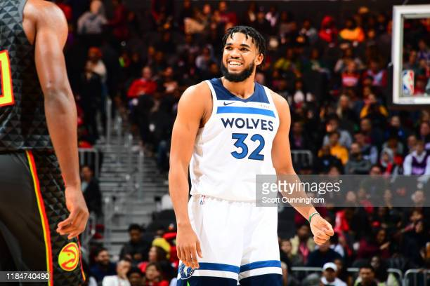 Karl-Anthony Towns of the Minnesota Timberwolves smiles during a game against the Atlanta Hawks on November 25, 2019 at State Farm Arena in Atlanta,...