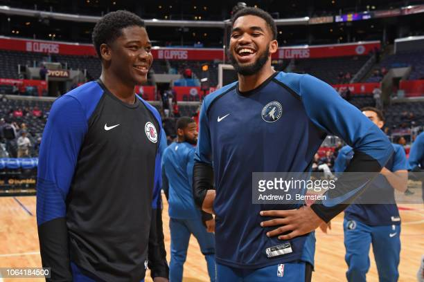 KarlAnthony Towns of the Minnesota Timberwolves speaks to Angel Delgado of the LA Clippers before the game during a preseason game on October 3 2018...