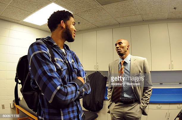 KarlAnthony Towns of the Minnesota Timberwolves speaks to Kobe Bryant of the Los Angeles Lakers after the game in the locker room on December 9 2015...