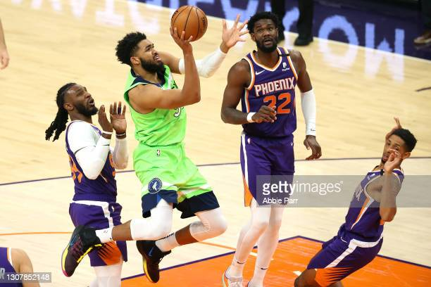 Karl-Anthony Towns of the Minnesota Timberwolves takes a shot in the second quarter against the Phoenix Suns at Phoenix Suns Arena on March 18, 2021...