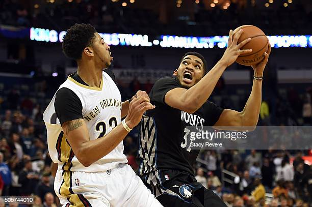 KarlAnthony Towns of the Minnesota Timberwolves works against Anthony Davis of the New Orleans Pelicans during the second half of a game at the...