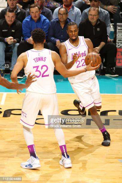 KarlAnthony Towns passes the ball to Andrew Wiggins of the Minnesota Timberwolves during the game against the Charlotte Hornets on March 21 2019 at...