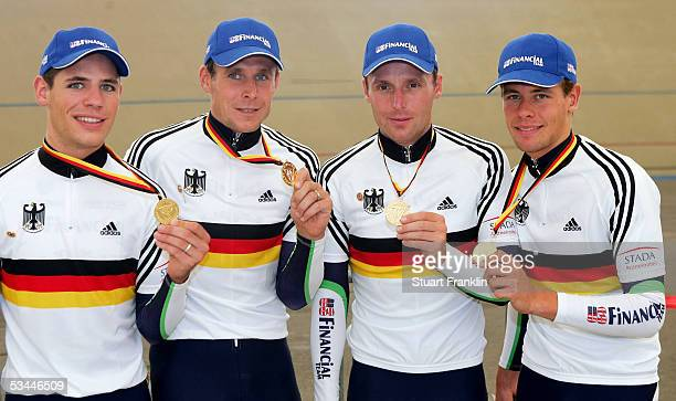 KarlChristian Konig Robert Bartko Guido Fulst Leif Lampater of The US Financial team with their gold medals from the 4000m team pursuit race at the...