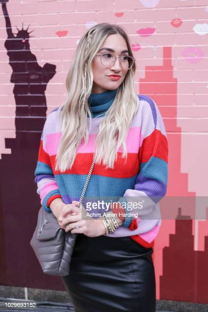 Karlee Andrews is seen wearing Revolve sweater, a black Mango skirt, shoes by Sole Society and a gray Yves Saint Laurent bag on the street during New...