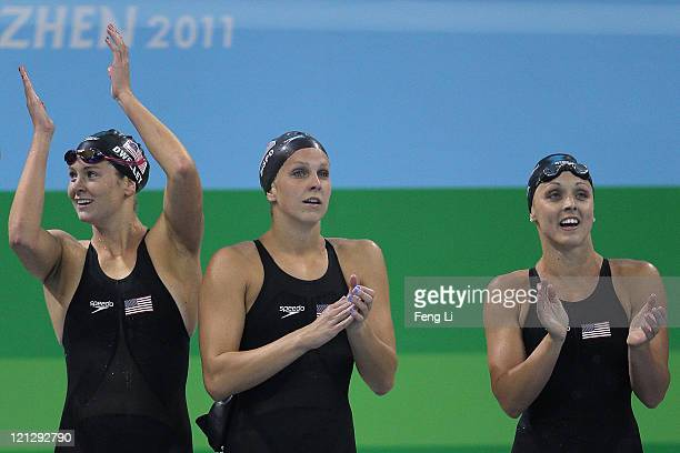 Karlee Bispo Chelsea Nauta and Kate Dwelley of Team USA cheer on Megan Romano on the way to winning the gold medal in Women's 4x200m Freestyle Relay...