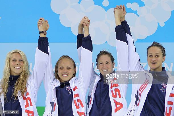 Karlee Bispo Chelsea Nauta Kate Dwelley and Megan Romano of United States of Team USA pose with their gold medals in Women's 4x200m Freestyle Relay...