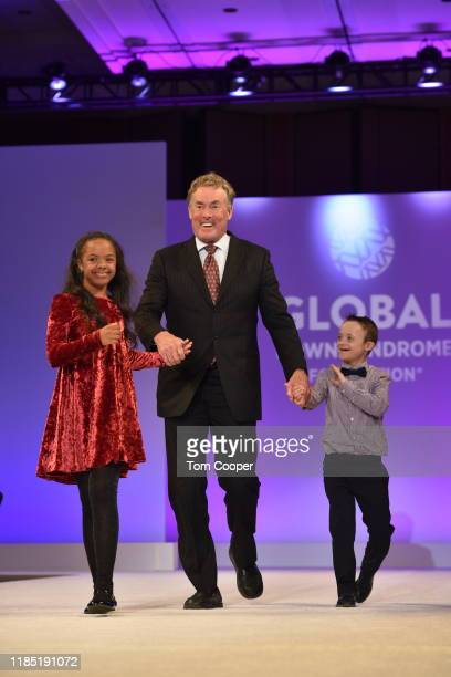 Karlena Somerville with John C McGinley and Ashton Scheppers on the runway at the Global Down Syndrome Foundation's Be Beautiful Be Yourself Fashion...