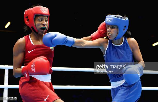 Karlha Magiliocco of Venuzuela in action with Erica Matos of Brazil during the Women's Fly Boxing on Day 9 of the London 2012 Olympic Games at ExCeL...