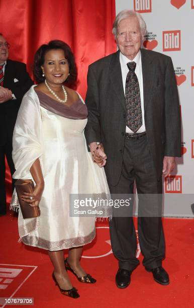 Karlheinz Boehm and his wife Almaz Boehm attend the 'Ein Herz Fuer Kinder' charity gala at Axel Springer Haus on December 18, 2010 in Berlin, Germany.