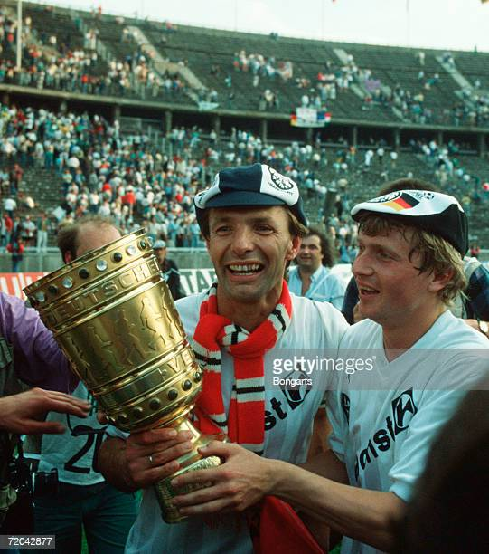 KarlHeinz Koerbel and Lajos Detari of Frankfurt celebrate with the trophy after winning the DFB German Cup final between Eintracht Frankfurt and VfL...