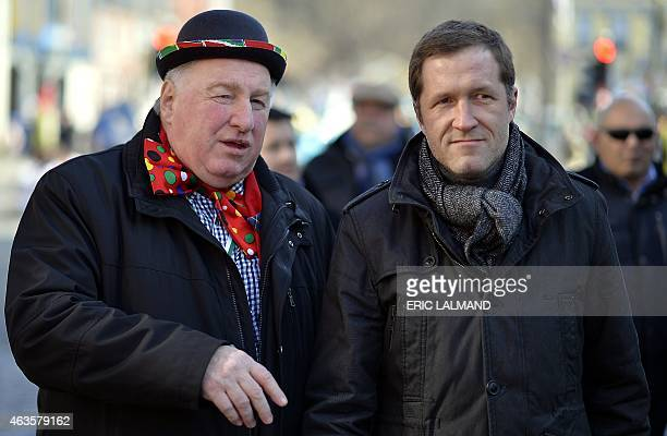 KarlHeinz Lambertz chairman of the German community parliament and Walloon Minister President Paul Magnette attend the Rosenmontag Carnival on Shrove...