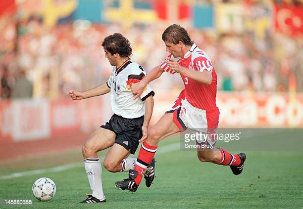 KarlHeinz Riedle of Germany shields the ball from Kent Nielsen of Denmark during the UEFA European Championships 1992 Final between Denmark and...