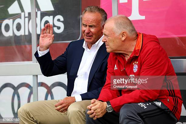 CEO KarlHeinz Rummenigge and assistant coach Hermann Gerland of Bayern Muenchen sit on the bench prior to the friendly match between SV Lippstadt and...