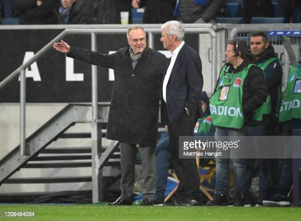 KarlHeinz Rummenigge and Dietmar Hopp come down to the field of play after demonstrations during the Bundesliga match between TSG 1899 Hoffenheim and...