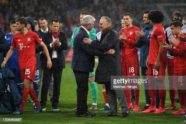 Karl-Heinz Rummenigge and Dietmar Hopp come together with players to applaud the home fans after demonstrations after the Bundesliga match between...