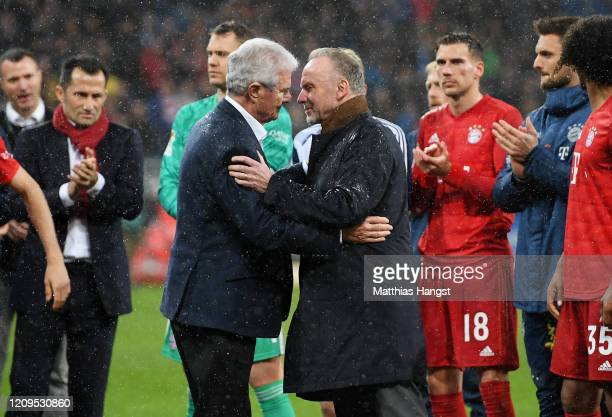 KarlHeinz Rummenigge and Dietmar Hopp come together with players to applaud the home fans after demonstrations after the Bundesliga match between TSG...