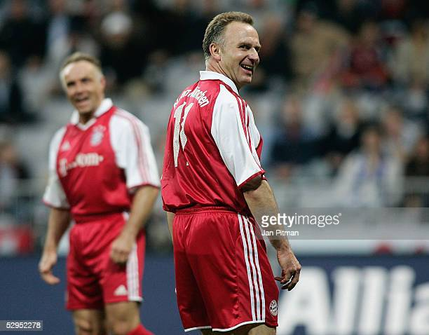 KarlHeinz Rummenigge and his brother Michael Rummenigge smile during the opening match of the AllianzArena on May 19 2005 in Munich Germany Former...