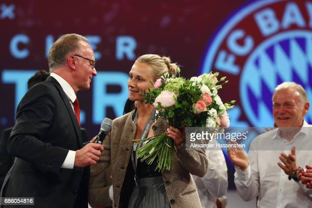 KarlHeinz Rummenigge and team manager Kathleen Krueger during the FC Bayern Muenchen Championship party following the Bundesliga match between Bayern...