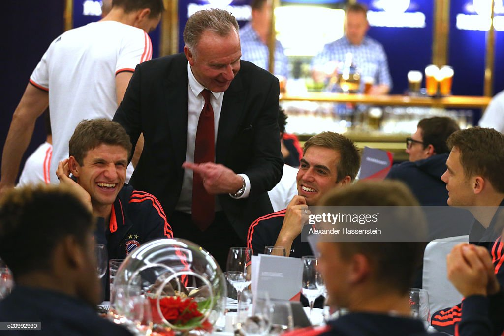 Karl-Heinz Rummenigge (back), CEO of Bayern Muenchen of Muenchen jokes with his players Thomas Mueller (L), Manuel Neuer (R) and Philipp Lahm (C) at the Champions Banquette at EPIC SANA Lisboa Hotel after winning the UEFA Champions League quarter final second leg match between SL Benfica and FC Bayern Muenchen at Estadio da Luz on April 13, 2016 in Lisbon, Portugal.