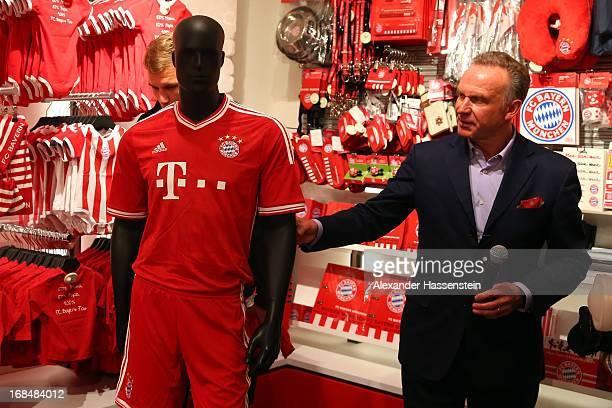KarlHeinz Rummenigge CEO of Bayern Muenchen presents the new home kit of FC Bayern Muenchen for the 2013/2014 season during the opening of the new FC...