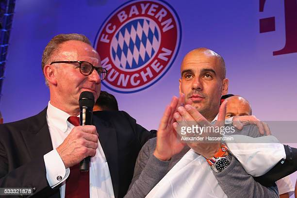 KarlHeinz Rummenigge CEO of Bayern Muenchen speaks to Josep Guardiola head coach of Bayern Muenchen at the FC Bayern Muenchen champions party at...