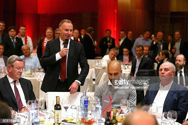 KarlHeinz Rummenigge CEO of Bayern Muenchen speaks whilst Karl Hopfner President of Bayern Muenchen looks on with Josep Guardiola head coach of...
